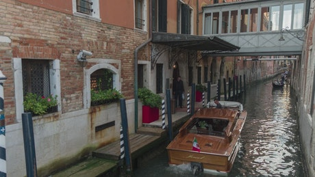 A canal in Venice with boats with tourists