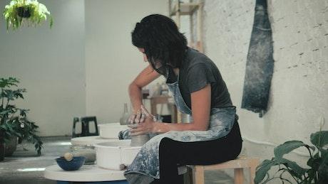 A ceramic artist working