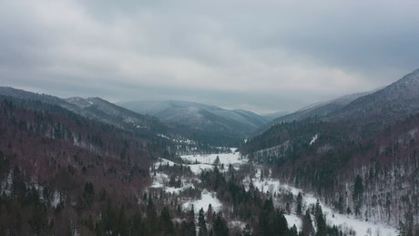 A cinematic mountainous valley during winter