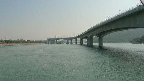 A concrete bridge over the water