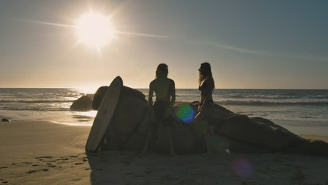 A couple at the beach at sunset