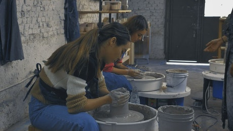 A couple of girls during a pottery class