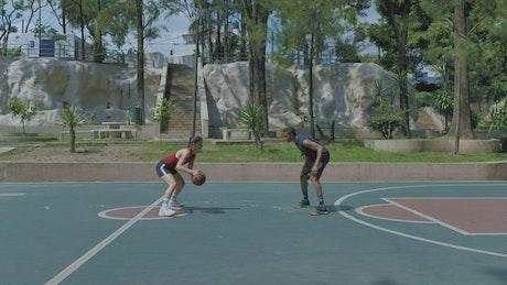 A couple playing basketball