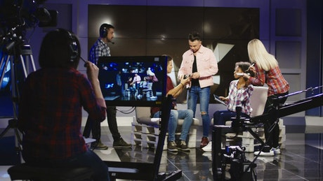 A crew in a television studio getting people ready