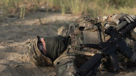 A dead soldier laying on the ground
