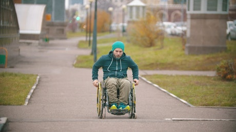 A disabled man makes failed attempt to steer his wheelchair over a ramp
