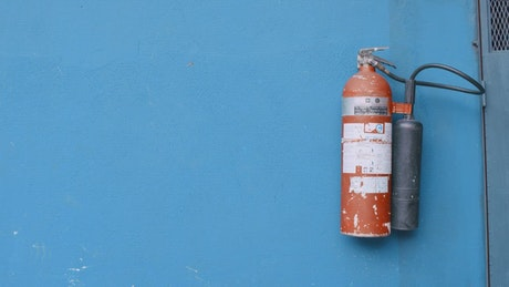 A fire extinguisher hanging on the wall