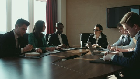 A group of businessmen in a conference room