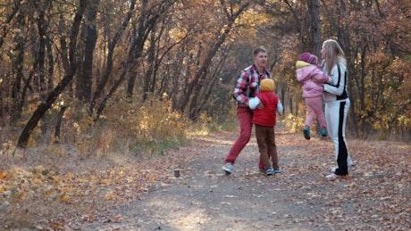 A happy family enjoying the autumn park