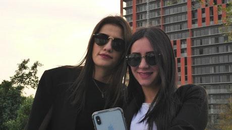 A LGBTQ couple takes a selfie