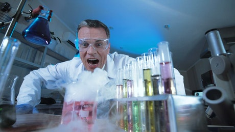 A mad scientist watching chemical reaction