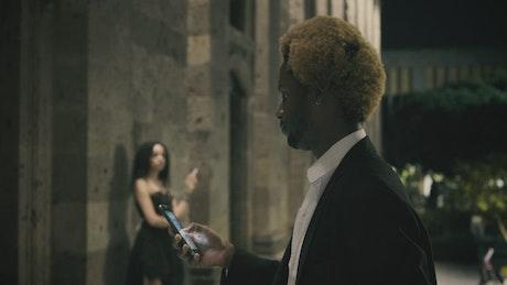 A man approaches a woman