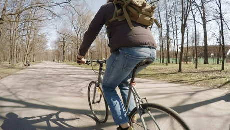 A man riding in a bike in the park