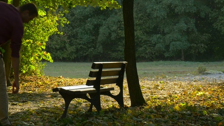 A man sitting in a park bench