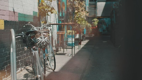 A man takes a bicycle from bike parking