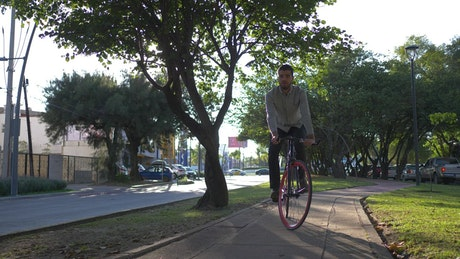 A man taking a ride with his bike