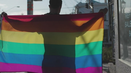 A man with a rainbow flag