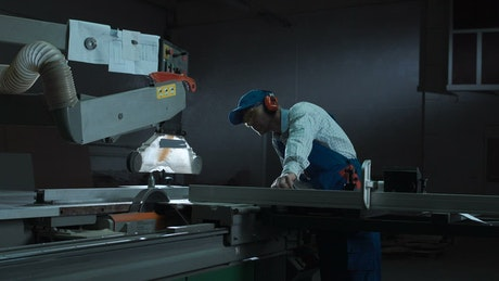 A man working with a saw in the workshop