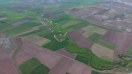 A meandering river between the agricultural fields