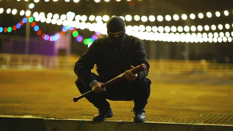 A menacing thug with a baseball bat