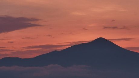 A mountain silhouette during sunset