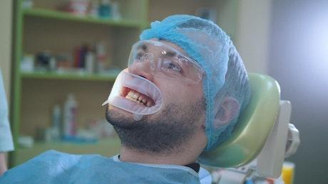 A patient receiving dental treatment