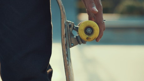A person spins the wheel of a skateboard with his finger