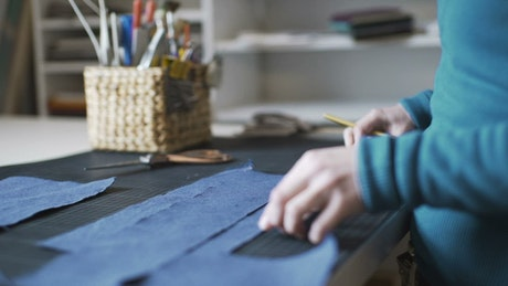 A person working with fabric