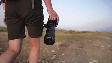 A photographer walking in nature