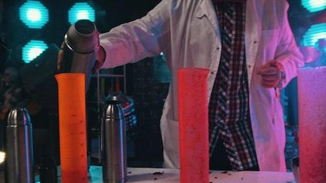A scientist pours the liquid nitrogen into flasks