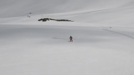 A skier descending in the snow