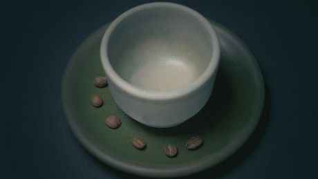 A small cup of coffee being filled