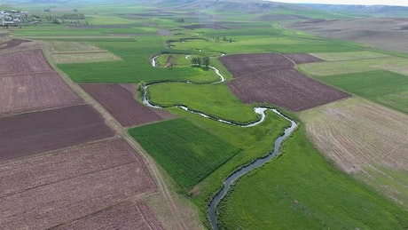 A small river and crop fields