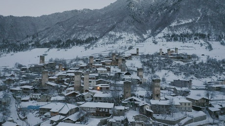 A town with old towers covered in snow