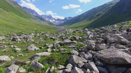 A valley filled with rocks and a stream