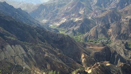 A village between a mountainous valley