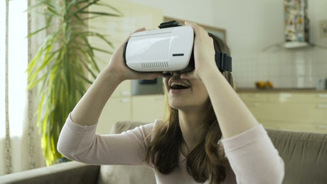 A woman amazed with VR