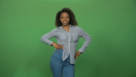 A woman dancing in front of a green screen