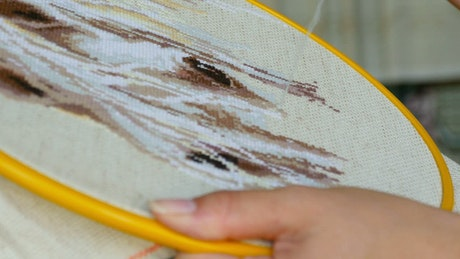 A woman doing needlework