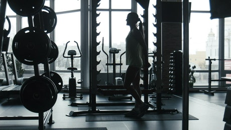 A woman doing squats in the gym