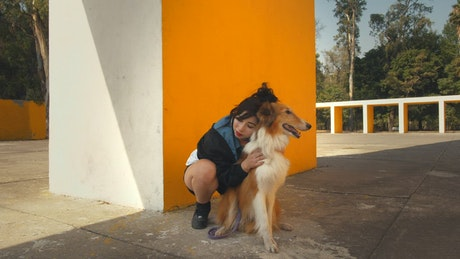 A woman hugging a dog