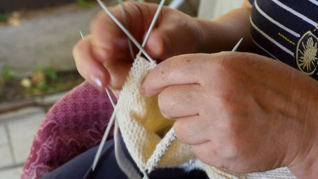 A woman is knitting