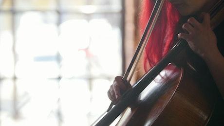 A woman plays the Cello