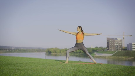 A woman practicing yoga outdoors