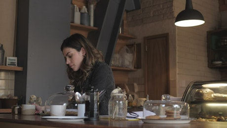 A woman reading a book at a coffee shop