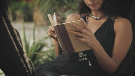 A woman reading on a hammock