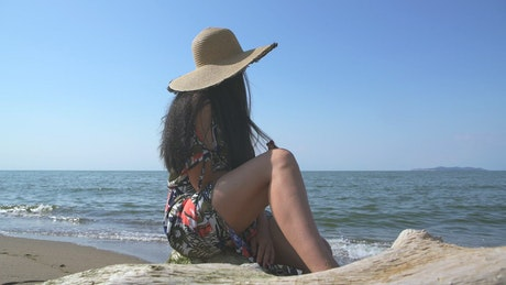 A woman staring at the ocean