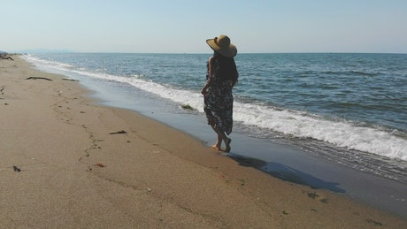 A woman walking in a deserted beach