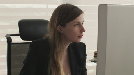 A woman working in her office