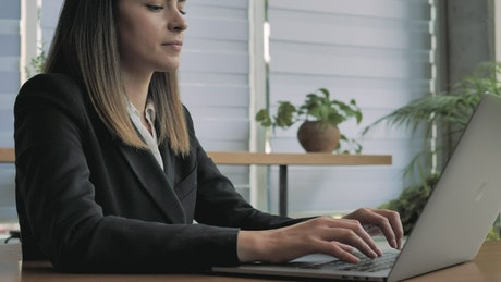 A woman working with her laptop